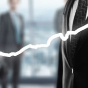 a person drawing an upward arrow, which represents business growth